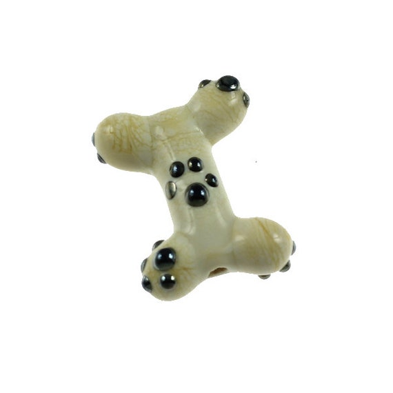Raised Silver Paws Bone - Ivory and Raised Metallic Dots - Glass Lampwork Dog Bone Bead