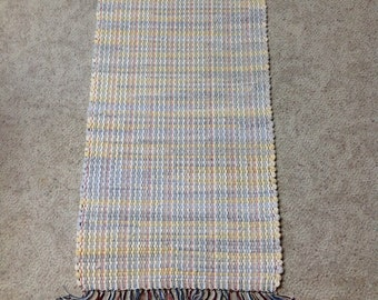 Rag Rug 44 inches long by 18 inches wide yellow, off white, and light gray upcycled sweatshirts