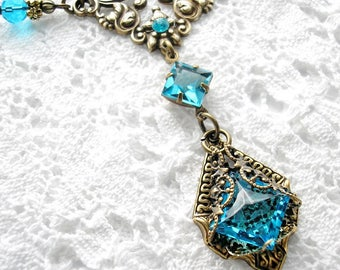 Out of the Mist - Aquamarine Glass Jewel Antiqued Brass Necklace