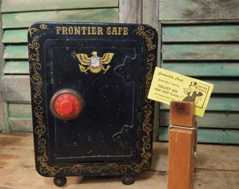 Fun vintage Frontier Safe toy metal bank with conbination lock and eagle graphic