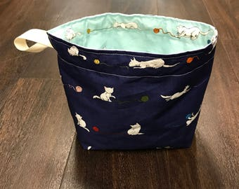 Reversible drawstring kitten bag