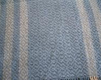 Handwoven table runner  in light blue with natural stripes