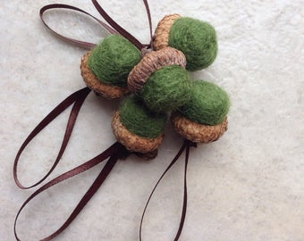 5 wool needle felted acorn ornaments in moss green with brown ribbon hangers