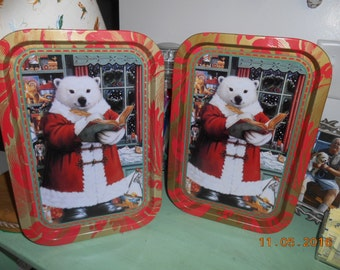 This is a vintage set of 2 metal Christmas Serving Trays Polar Bear Santa