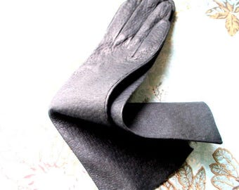 Classy vintage 60s, charcoal black,  textured kid, table cut, opera gloves. Marshal Field. Size 6 1/2. MInt condition.