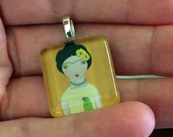 Frida with Parrot  - Original Small Glass Tile Pendant  by FLOR LARIOS ART