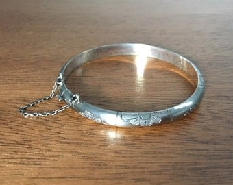 Vintage Sterling Silver floral hinged bangle with safety chain