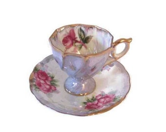 Sonsco iridescent  china demitasse cup and saucer set - Moss rose - Lusterware - Blue background - Japan - Mid century