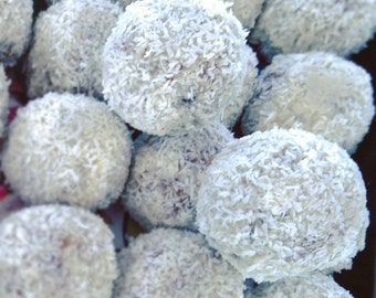 A bag of 3 Raw Vegan Rawphaello coconut energy snow balls with sukkary caramel. Organic and no gluten or sugar