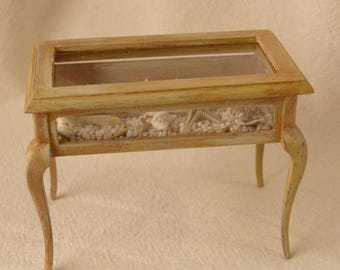 Dollhouse miniature coffee showcase table with sea shells collection in an antique decape style
