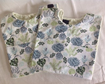 Baby bib with crumb catcher pocket with desert and southwestern motif