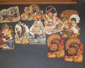 9 Vintage Thanksgiving Die Cut Decorations. turkeys, pilgrims, native americans. Hallmark and unmarked