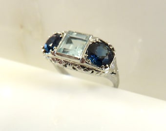 Circa 1930 Aquamarine and Sapphire ring set in 18KT white gold