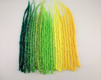 24 Yellow to Green synthetic dreads. Synthetic dreads, dreadlocks, dreads, synthetic dreadlocks, dreadlock extensions, single ended dreads