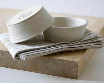 Two minimalist style tapas snack bowls - glazed in vanilla cream