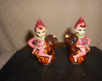 Elves or  Pixie Salt and Pepper  shakers sitting on tree stump
