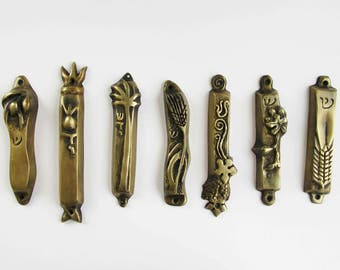 Set of 7 bronze large mezuzahs from the seven species series, judaica designed by Shaul Baz,