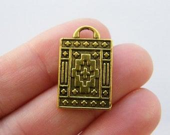 6 Magic carpet charms antique gold tone GC70