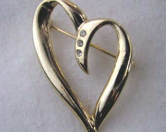 Gold tone vintage open heart shaped pin with rhinestones