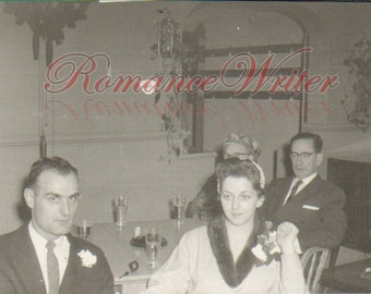 At the Reception Vintage Photo of a Bride and Groom Sitting at a Table