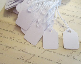 200 strung marking tags- 1-3/32 x 3/4 inch - white tags with strings - small tags, paper tags