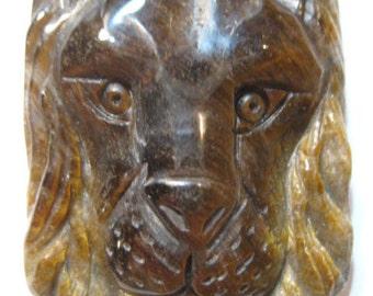 Carved Tiger's Eye Lion pendant bead ...  41 x 33 x 10 mm ....     B4010