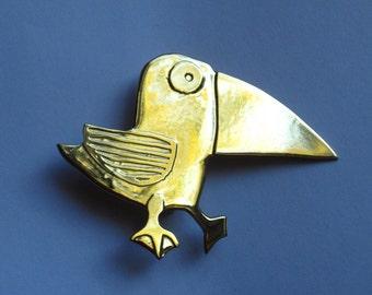 bird brooch with big beak