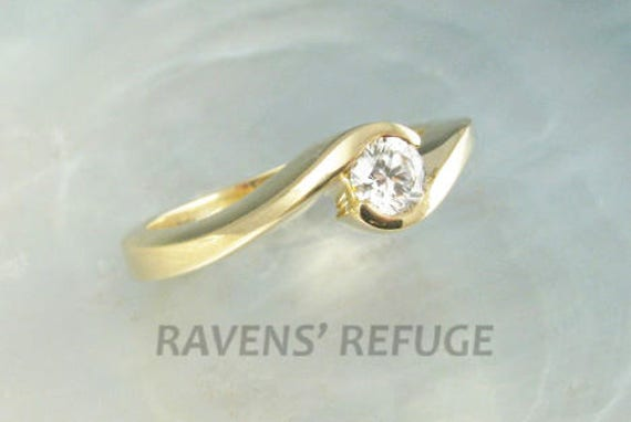 conflict-free diamond engagement ring in 14k yellow gold