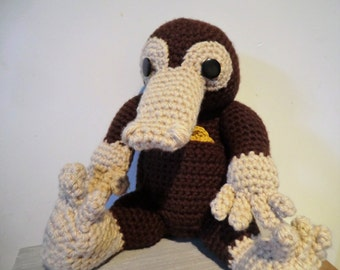 Life-size Niffler and coins amigurumi PDF crochet pattern inspired by Harry Potter and Fantastic beasts and where to find them