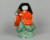 Asian art doll, Very beautiful, holding a lantern, Silk padded jacket and skirt. Very solid, for display only, Porcelain head Black hair