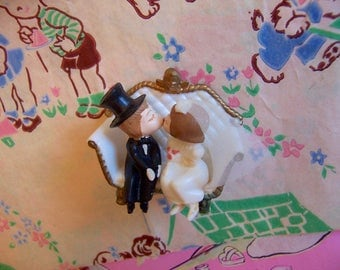 bride and groom on a bench cake topper