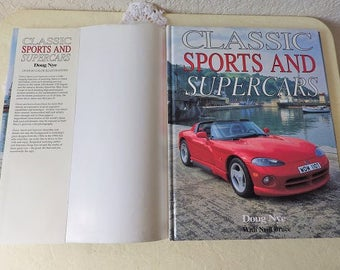 Classic Sports and Supercars, Hardcover book with dust jacket in near new condition, 1995.