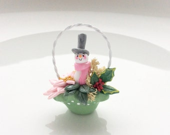 Dollhouse Christmas basket with pink poinsettia, holly and a snowman handmade from polymer clay