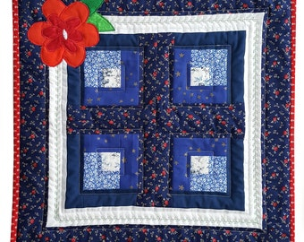 Quilted Table Mat,  Patchwork for your Kitchen, Dining, Home Decor, red and blue with a bright red applique flower