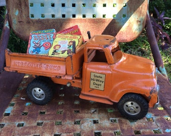 This Vintage 1950s Tonka State Hi-Way Dept Toy Truck Saw His Fair Share Of Play