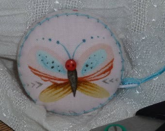 Tulip and butterfly tape measure, covered with  Dream Catchers from Studio E Fabrocs