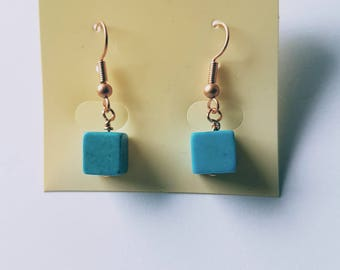 Blue, turquoise magnesite cube copper earrings. Hook fastening.