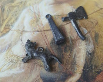 Great Very old turn-of-the-century lead charms kitty cat and Ax