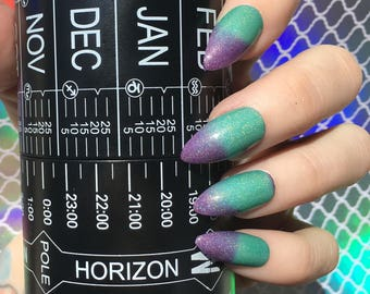 Northern Lights color changing nail polish purple to teal thermal vegan holographic