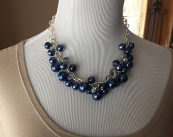 Chunky statement necklace with navy pearls and fancy silver chain.