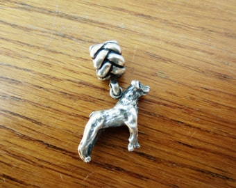 Small silver dog charm with slide bead.  Great gift.  Necklace or slide bracelet silver dog charm.