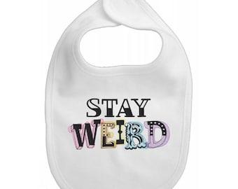 Stay Weird embroidered feeding bib.