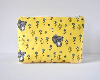 Woman's beauty padded cosmetics pouch raccoon animal make up bag travel in forest novelty animal print in yellow.