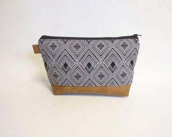 Black/gray geometric makeup bag with brown faux leather