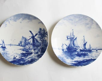 Pair of Delft blue and white wall plates, Delft Holland decorative plates