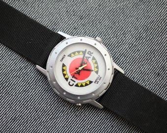 Vintage Timex Citywear quartz watch with black canvas strap
