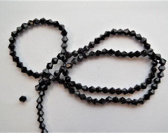 Black faceted 4mm AB Spacer beads. Approximately 116CT (1 strand) K66C