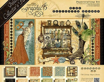 Graphic 45 Olde Curiosity Shoppe  Deluxe Collection, 2 Sets of 12 Double Sided Papers (24 total), 1-Set of Chipboard Tags, 1-Sticker Sheet