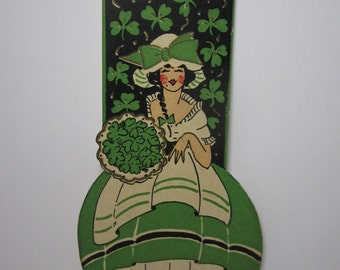 Art deco die cut 1920's-30's unused Gibson St. Patrick's Day bridge tally pretty lady dressed in green dress holds bouquet of green clover