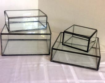A variety of sizes of clear glass display boxes to keep your special memories